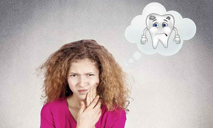 дополнительные симптомы почернения зуба под пломбой